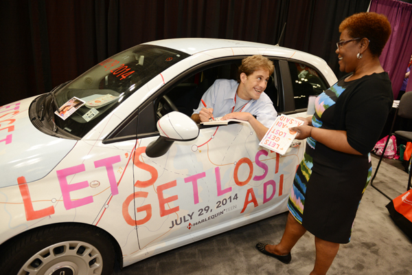 Alsaid in the 'Let's Get Lost' Fiat 500, on the floor at BEA. SteveKagan.com
